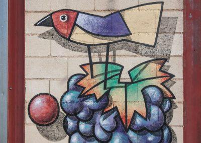 Pájaro y uvas